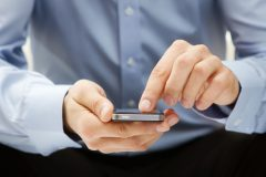 11326201 - close up of a man using smartphone